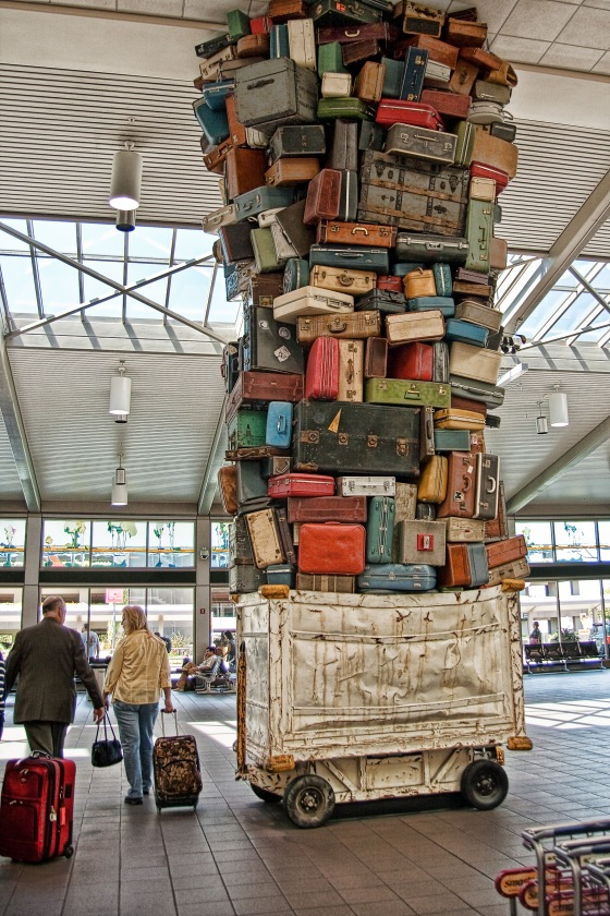 If your suitcase is in this pile, it better be a sturdy one. Photo by Laura Gilmore.